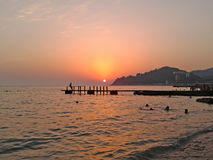 Beautiful sunset at the Black Sea coast. Beautiful sunset on the Black Sea shore, summer vacation, resort Sochi, Russia Stock Images
