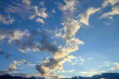 Beautiful sunset blue sky and yellow pastel clouds stock photo