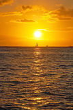 Beautiful sunset with boat on ocean on Hawaii Royalty Free Stock Images