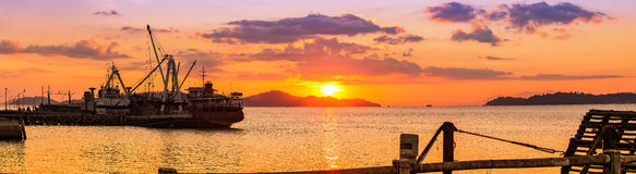 Beautiful sunset at Bodin pier, Ranong, Thailand. Cargo ship docking port for transporting goods from trucks at sunset time. Bodin pier, Ranong, Thailand stock photo