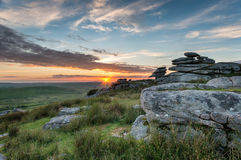 Beautiful Sunset on Bodmin Moor. Beautiful sunset over a granite tor at the Cheesewring on Stowes Hill near the Minions on Bodmin Moor in Cornwall Stock Images