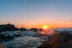 Beautiful sunset on the boundless sea, Rocky. A beautiful sunset on the boundless sea, Rocky royalty free stock images