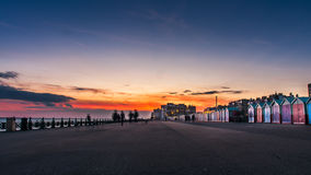 Beautiful sunset in Brighton, UK. Row of beach huts of Hove, vintage effect filter style Stock Photos