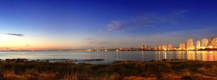 Beautiful sunset at building seashore Stock Image