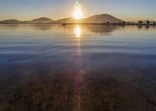 Beautiful sunset on the calm Aegean Sea on the island of Evia, Greece. Beautiful sunset on the calm Aegean Sea on the island of Evia Greece royalty free stock photography
