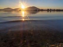 Beautiful sunset on the calm Aegean Sea on the island of Evia, Greece. Beautiful sunset on the calm Aegean Sea on the island of Evia Greece royalty free stock photos
