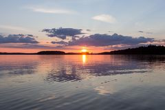 A beautiful sunset at calm Lake. Finland. stock photo