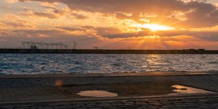 Beautiful sunset captured by the moment the sun is going down in the sea. Thessaloniki Greece february 11 2019 : Beautiful sunset captured by the moment the sun royalty free stock photography