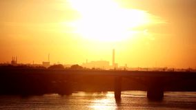Beautiful sunset in the city on the bridge and sea background. 1920x1080 stock footage