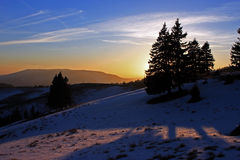 Beautiful sunset in Ciucas mountains, Romania, during the winter Stock Images
