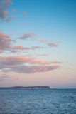 Beautiful sunset cloud formation over calm sea landscape Royalty Free Stock Photography