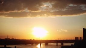 Beautiful sunset with clouds in the city on the bridge and sea background. 1920x1080 stock footage