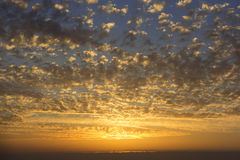 Beautiful sunset, clouds of golden color Royalty Free Stock Photography