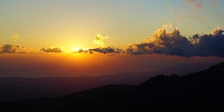 beautiful sunset with clouds over the mountains stock photos