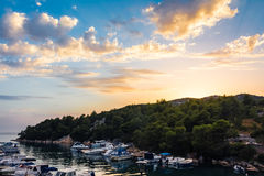 Beautiful Sunset Clouds over Mountains and Ocean in Croatia with Royalty Free Stock Images