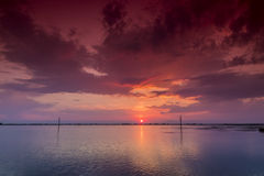 Beautiful sunset with clouds in the sky over ocean Royalty Free Stock Image