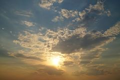 Beautiful sunset through the clouds stock photography