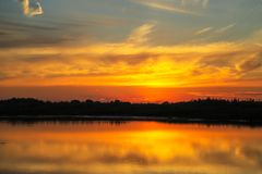 Beautiful sunset with clouds on the Volga river Royalty Free Stock Image