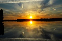 Beautiful sunset with clouds on the Volga river Stock Photo