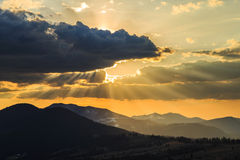 Beautiful sunset with clouds and yellow sky. In Calimani Royalty Free Stock Images