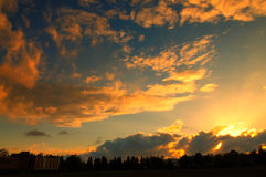 Beautiful sunset on a cloudy day Stock Photos