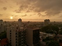 A beautiful sunset in the cloudy sky of a big city Stock Images