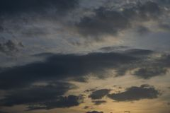 Beautiful sunset in the cloudy sky. Evening beautiful sunset in the cloudy sky royalty free stock photo