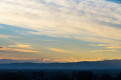 Beautiful Sunset Cloudy Sky And Mountains Royalty Free Stock Images