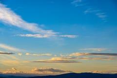 Beautiful Sunset Cloudy Sky And Mountains Stock Photo