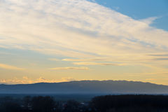 Beautiful Sunset Cloudy Sky And Mountains Royalty Free Stock Photography