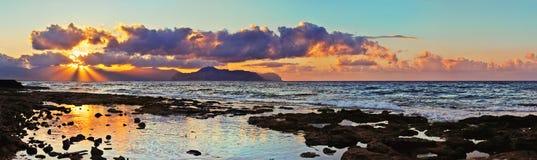 Beautiful sunset on the coast of Aspra. Stock Image