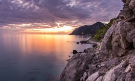 Beautiful sunset at the coast of central Corfu Greece.  Royalty Free Stock Images