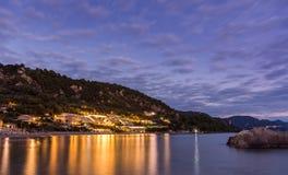 Beautiful sunset at the coast of central Corfu Greece.  Stock Photo