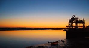 Beautiful sunset at Cristina island,Huelva,Spain. Beautiful sunset at Cristina island on holiday in summer , beautiful color of yellow and blue sky,Huelva,Spain Stock Photo