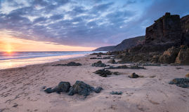 Beautiful sunset on a deserted beach. At Sandymouth near Bude in Cornwall Royalty Free Stock Images