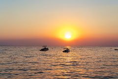 Beautiful sunset. In the distance you can see two small boats. royalty free stock photos