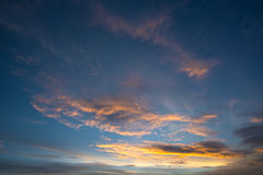 Beautiful sunset with dramatic clouds and dark sky. Royalty Free Stock Photos
