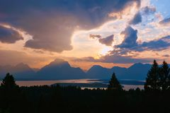 Dramatic Mountain Sunset with Clouds stock images