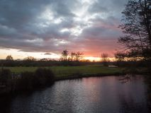 Beautiful sunset dramatic sky country dedham river water red aut. Umn; essex; england; uk Stock Photography