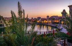 Beautiful sunset at Dubai river land park. With beautiful buildings and palm tress Stock Photography
