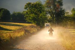 Beautiful sunset, dust and motorcycles Royalty Free Stock Photos