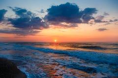 Beautiful sunset on  empty sandy beach. Beautiful sunset on an empty sandy beach Stock Image