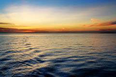 Beautiful sunset at the equator. View from ferry Stock Photos