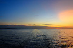 Beautiful sunset at the equator. View from ferry Royalty Free Stock Image
