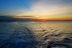 Beautiful sunset at the equator. View from ferry Royalty Free Stock Photos