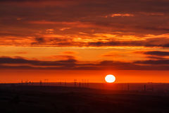 Beautiful sunset with factory electricity on horizon royalty free stock photography