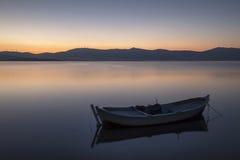 Beautiful sunset with fishing boat Stock Image