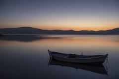 Beautiful sunset with fishing boat Stock Photography