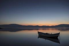 Beautiful sunset with fishing boat Stock Photos