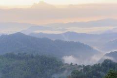 Beautiful sunset  floating fog landscape. Royalty Free Stock Photo